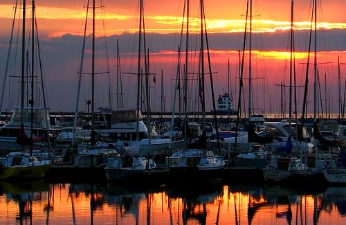 sunset summer sky sun lighthouse sailboat marina boats boat lakeerie greatlakes lorain impressedbeauty