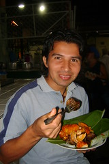 Miller Hernan eating a Rellena with many special animal organs in it
