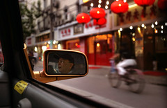 From the back seat of a cab.