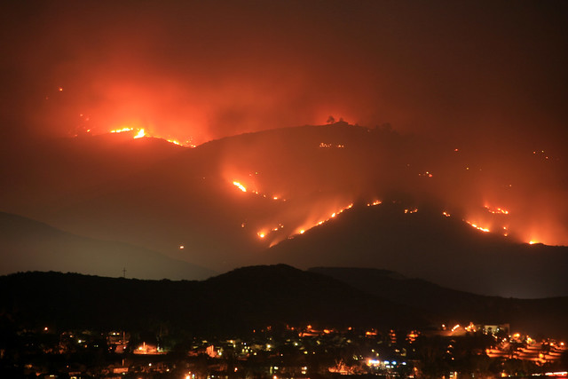Mt. San Miguel on fire and raging toward homes in the Harris Fire of 2007.  San Diego wildfires.