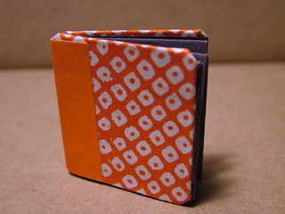 miniature book with strangely folded pages