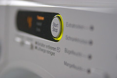Start/Stop button on a Miele tumble dryer   by viZZZual.com