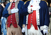 The Revolutionary War re-enactors pledge allegiance to the Alabama and U.S. flags
