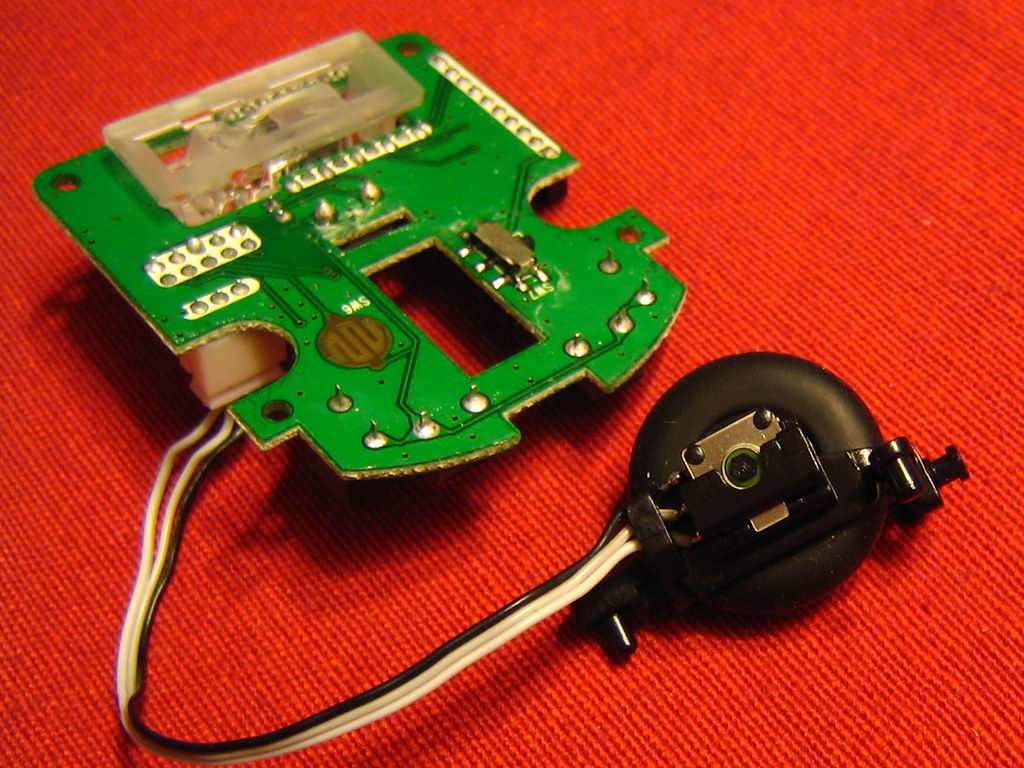 Mouse sensor PCB and scroll wheel   Disassembly of a Rocketf…   Flickr