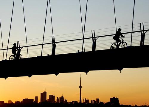 city bridge sky toronto bike bicycle silhouette skyline sunrise buildings dawn cyclist cntower rider 18200mm humberbaybridge beaterbikeblogto