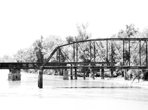 truss swing railroad railway train bridge neches river evadale texas historic black white blackandwhite blackwhite bw b w movable moving draw drawbridge pontist united states north america