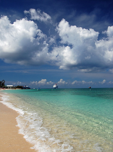 blue sea white beach water island islands sand surf waterfront sandy shoreline 7 grand resort seven shore tropical caribbean cayman sands carib isle mile