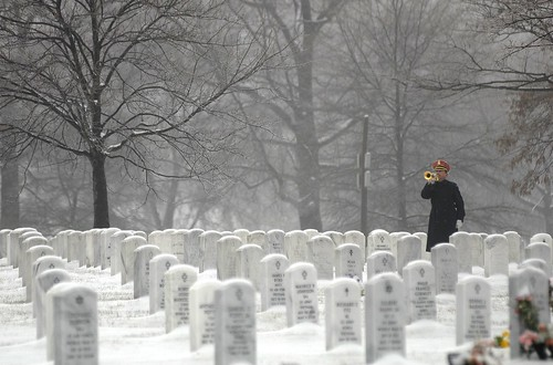 Taps is played on the bugle in the winter snow at Arlington National Cemetery | by Beverly & Pack