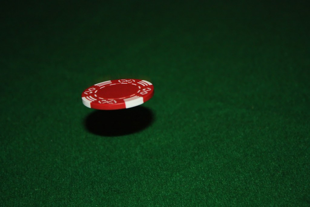 Floating Chip Bouncing A Poker Chip Off The Table With A