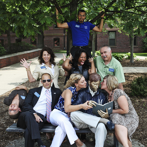 Millikin's Admission staff stops for a photo with the Bronze Man!