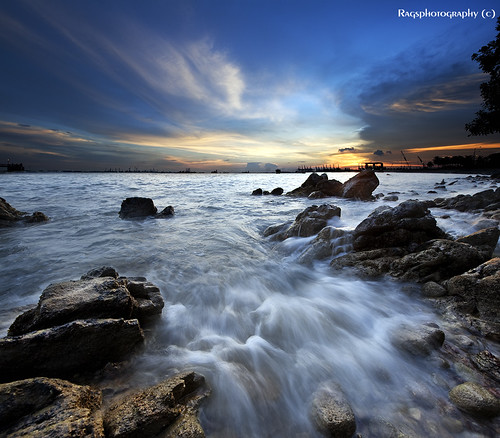 ocean travel sunset sea people holiday seascape tourism water rock relax photo google search nikon singapore asia waves rags culture visit photograph destination singaporebeach uniquelysingapore d700