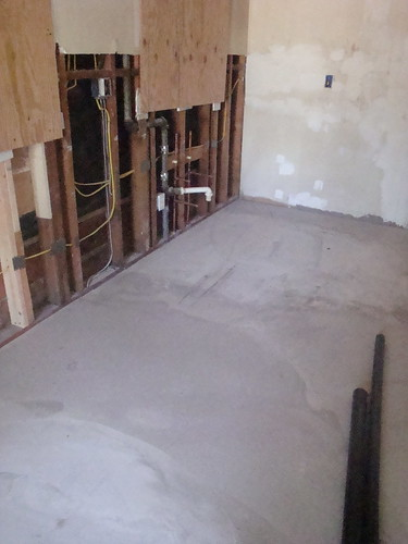Kitchen floor, leveled and ready for tile | by evanyevany