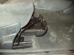 Renault Scenic. Cajón debajo del asiento del piloto. Antes