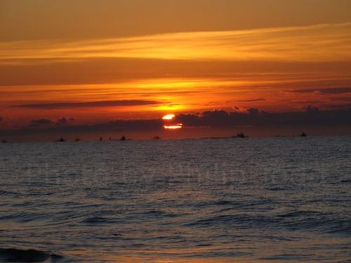 ocean sky sun beach water clouds sunrise boats boat nc waves north carolina rise holden