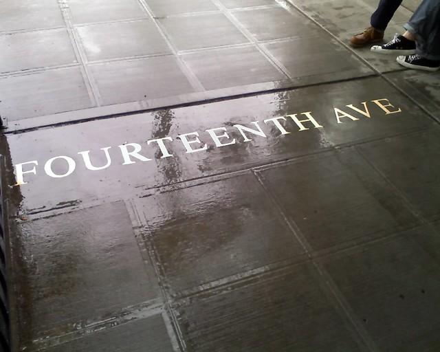 Seattle sidewalk street name: Fourteenth Avenue (at E. Union Street)