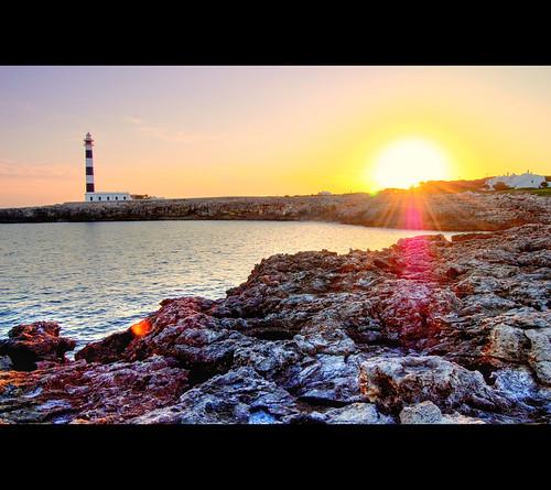 sunset sea en sun lighthouse water set island spain nikon rocks spanish flare hdr bosch menorca cala balearic d40 calaenbosch nikond40