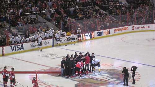 Carleton Ravens Basketball Team at the ceremonial face-off