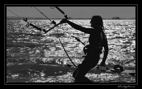 sunset blackandwhite reflection water girl silhouette aperture nikon delta bayarea kitesurf wetsuit d90 niksoftware viveza platinumheartaward silverefexpro