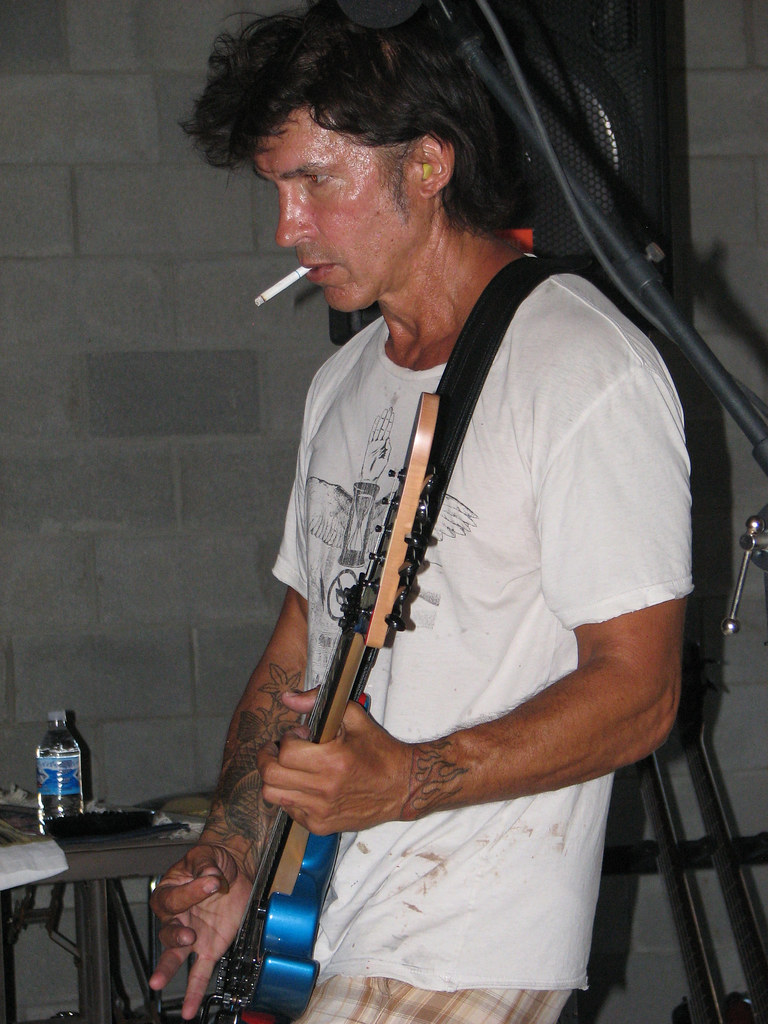 George Lynch smoking a cigarette (or weed)