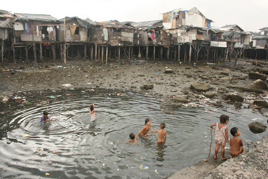dirty water in slums of manila bay | Children swimming in a … | Flickr