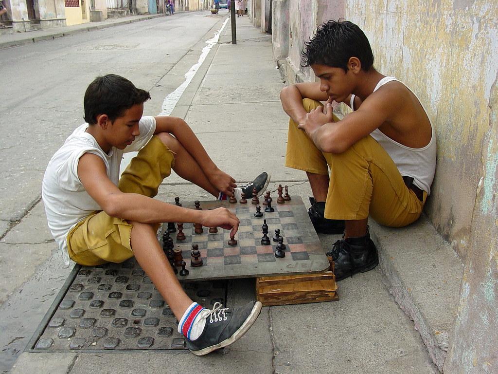 Boys Playing Chess on the Street - Santiago de Cuba - Cuba