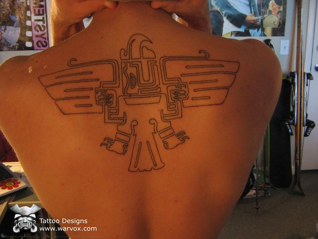 A tribal tattoo of an Aztec eagle with a grinning face and ...  |Mayan Eagle Tattoos