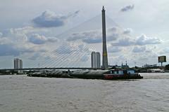 Rama VIII bridge and barges passing under it