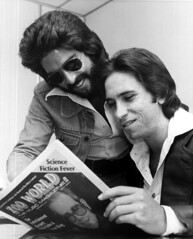 Kenny Loggins reading Zoo World music magazine with Jim Messina: Fort Lauderdale, Florida   by State Library and Archives of Florida