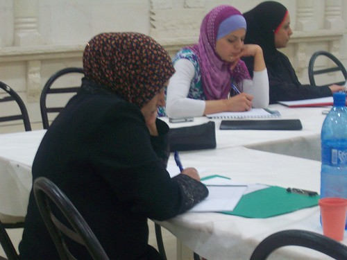 Training participant taking notes | by The Advocacy Project