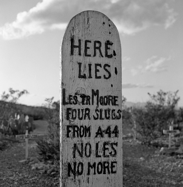 Here lies Lester Moore, four slugs from a 44, No Les No More