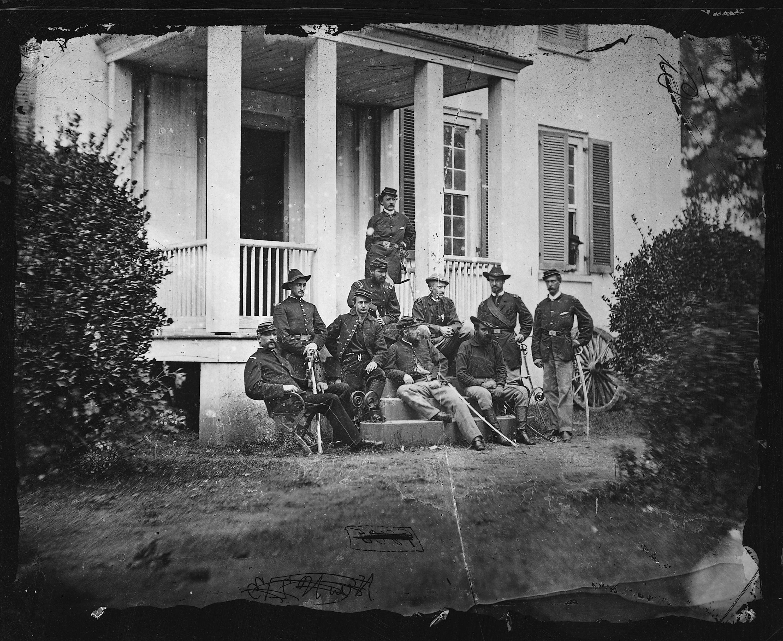 Major General James H. Wilson and Staff of Nine. Captain Louis Seibert, Captain Perkins, Captain Sayles, Major C.E. Hackley, Lieutenant Hull, Lieutenant J.W. Andrews, Lieutenant Yard, Captain Edward H. Noyes, Captain Russell.
