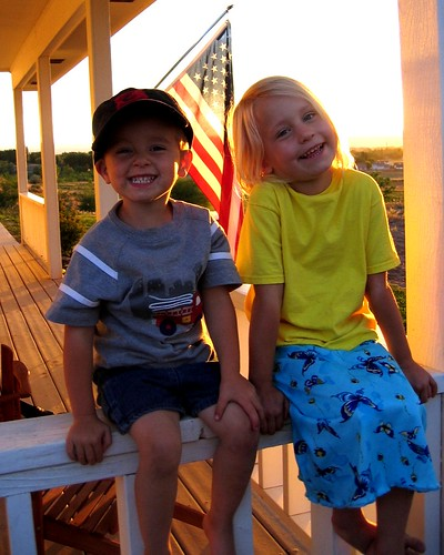 kid kids child children flag sunset porch happy sibling siblings brother sister smile youth american cute