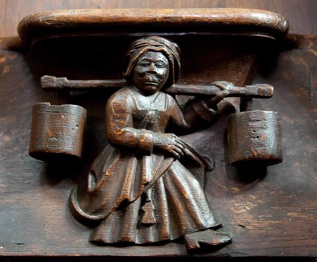 Vendome - La Trinite - Choir Stalls - Woman with Buckets
