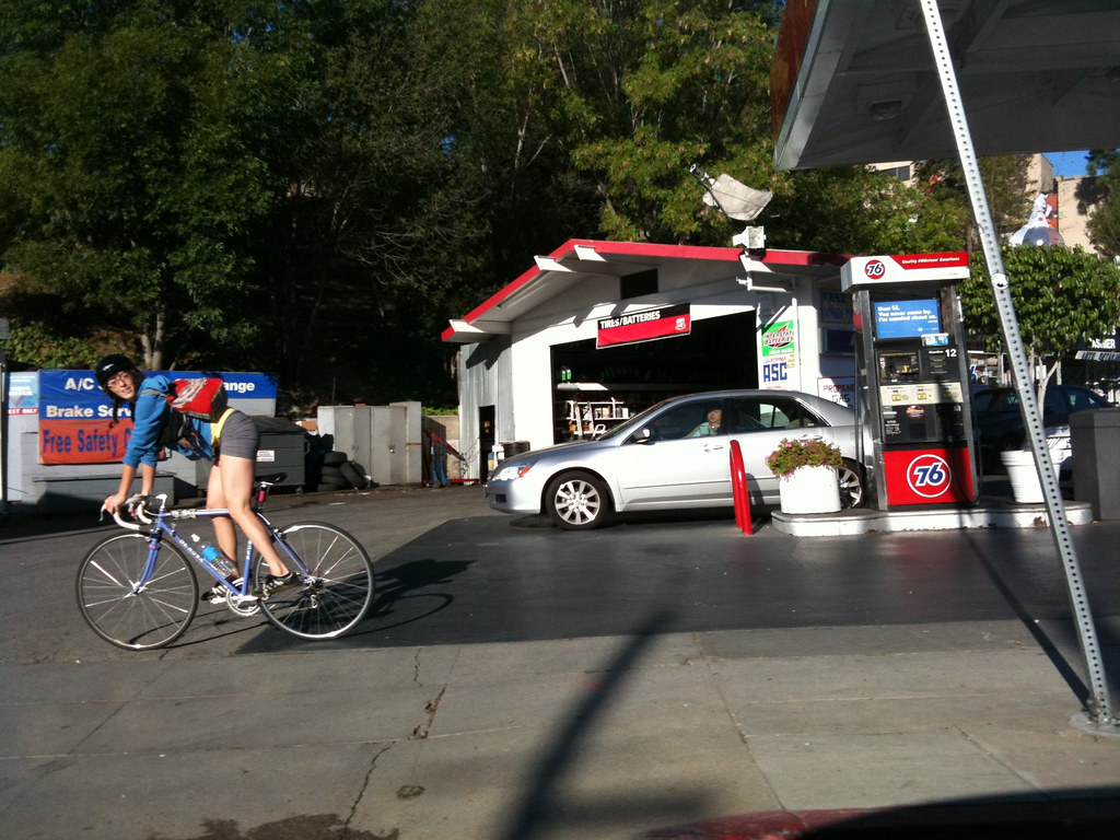 Cyclist at Gas Station