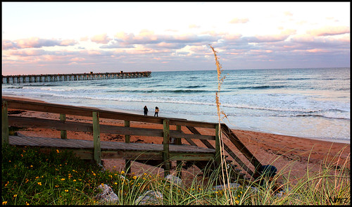 ocean light sunset sea people usa sun art tourism beach water sunshine clouds canon landscape geotagged pier sand view state artistic florida cloudy sunny bluesky breeze sandpiper atlanticocean flagler beachview flaglerbeach canon40d canonrebelxsi nmrz