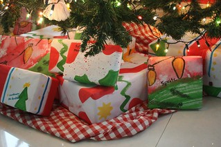 wrapped gifts under tree | by jimmiehomeschoolmom