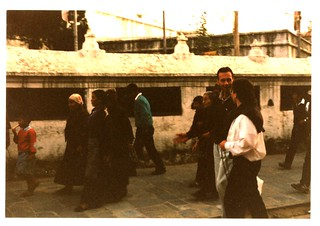 Buddhist pilgrims Bill Sternhagen, Gerhardt Forte,  and Ani Chime (a nun, the sister of Dezhung Rinpoche III) walking clockwise around Boudha Stupa with Tibetans, Boudha, Kathmandu, Nepal, 1990