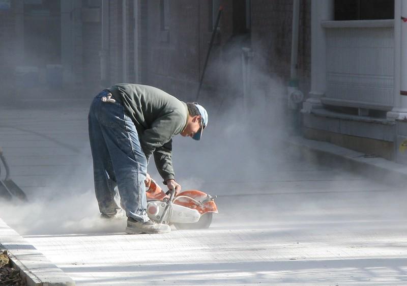 Man using concrete cutter