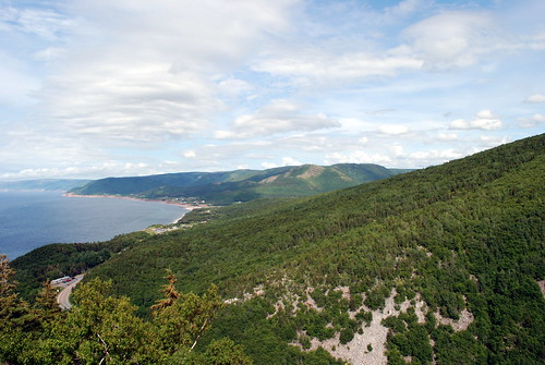 ocean road trees sky novascotia capebreton winding cabottrail