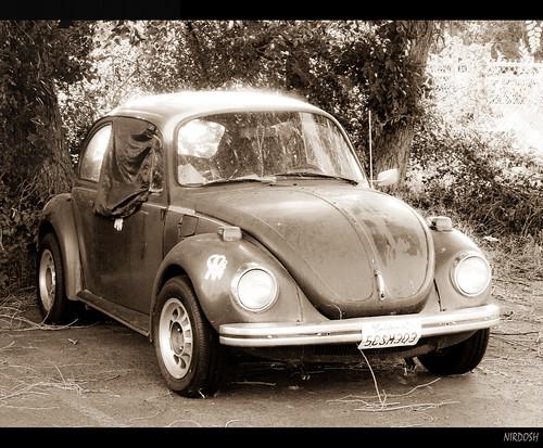 sepia geotagged parkinglot shine rusty dirty oldcar leftalone oldbloke geo:lat=40261025 geo:lon=111663033