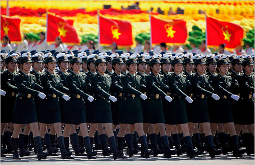 Women in military formations representing the People's Liberation Army of the People's Republic of China during their national commemorations honoring the 60th anniversary of the socialist revolution of 1949.