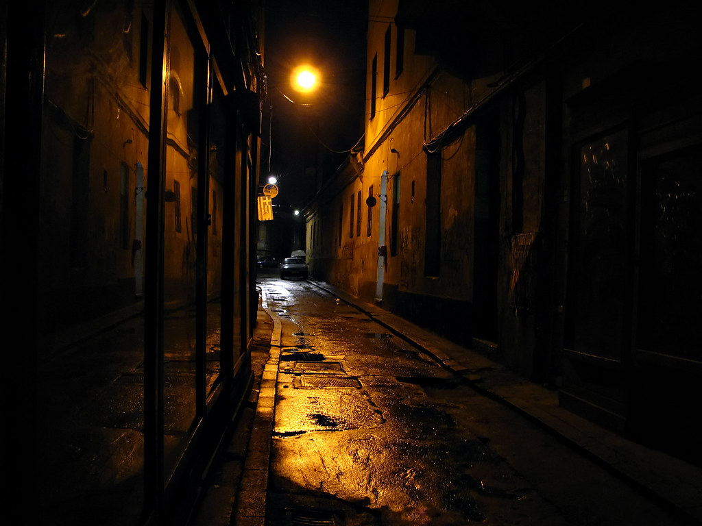 On a dark alley   Cluj, old city center, just off the ...