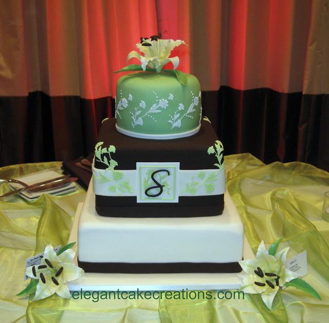 Lilies and monogram wedding cake