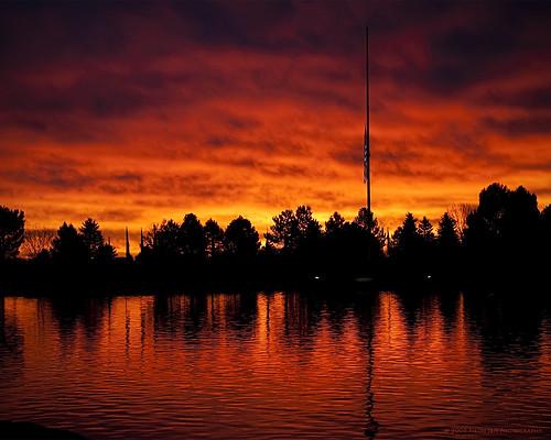 morning orange lake reflection cemetery yellow clouds sunrise memorial colorado flag military duty honor americanflag denver veteran patriotism sacrifice veteransday halfstaff d300 forthood fortlogan fortlogannationalcemetery nikond300 nikkor18200mmf3556gifed incineratorlake