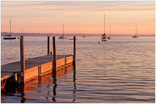 morning water sailboat sunrise reflections boats pier dock daybreak muskegonlake stacyniedzwiecki stacycossolini puremichigan