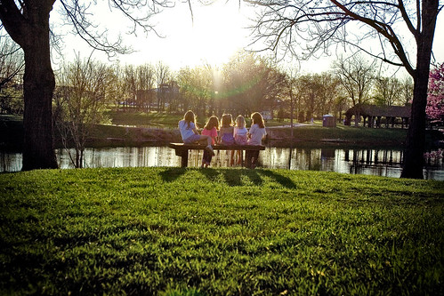 park friends sunset sky sun lake reflection grass kids bench children rays