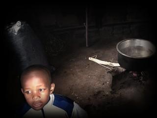 Heating up bath water, Limuru, Kenya