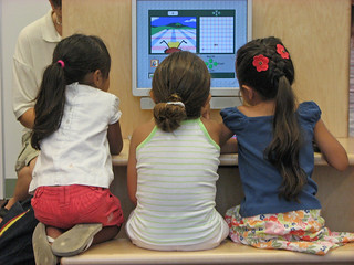 Three girls using the computer at the grand opening. | by San José Public Library