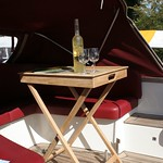 The Zijlsloep can be fitted with any type of extra you might wish, such as a teak table, electric 12V outlets, other cover types and (boom) tents, heavy duty batteries and so on. (On display at Schippertjesdagen Warmond)