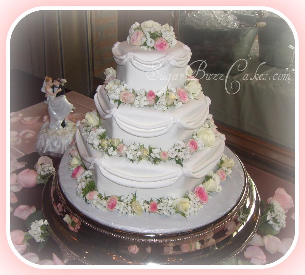 Three tier hexagon swag wedding cake